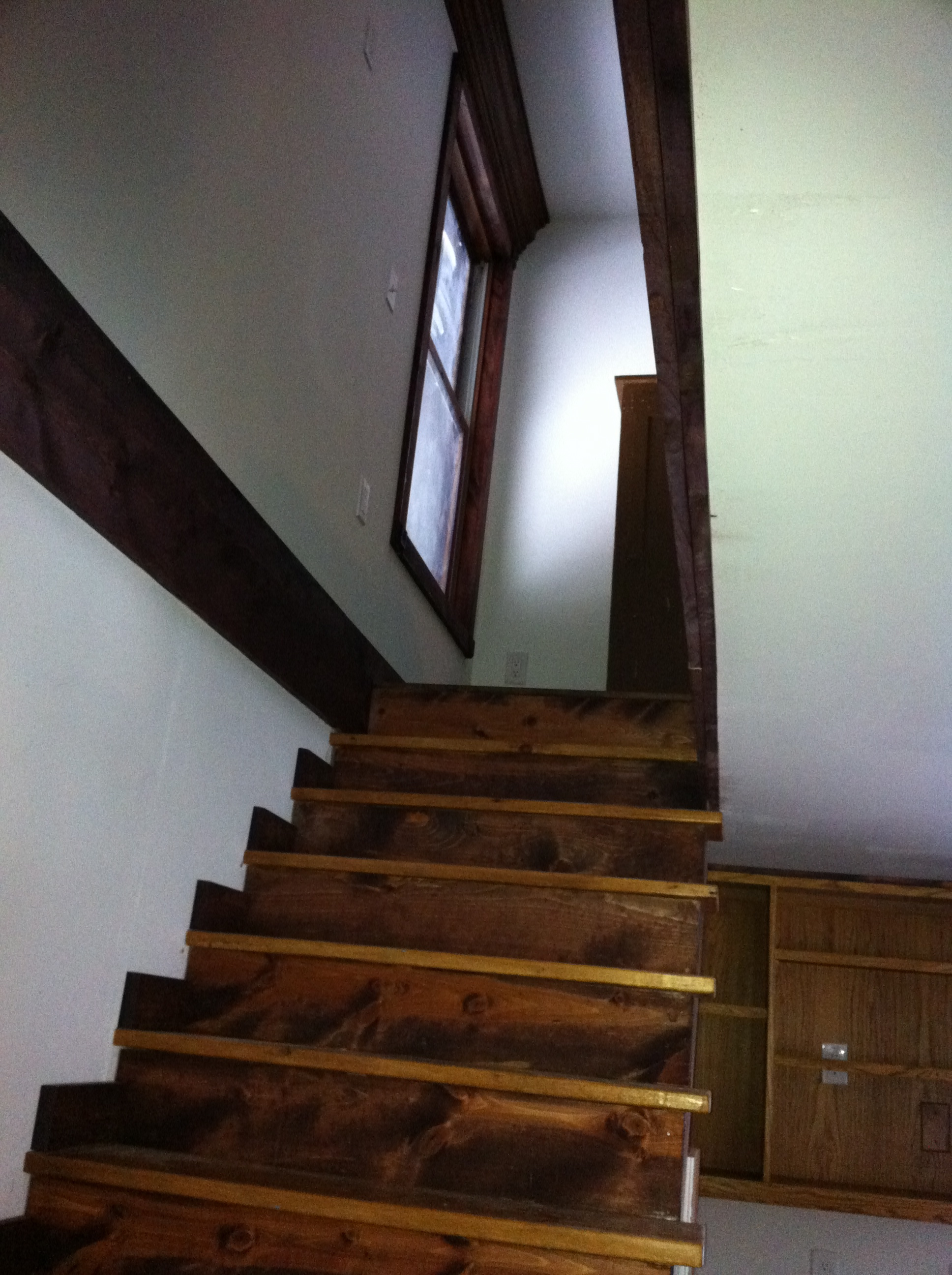 16 - A view of the upstairs with finished steps and stained woodwork