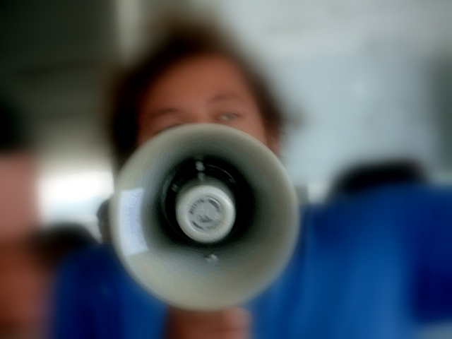 Megaphone Image to illustrate broadcasting communication with IM and Twitter