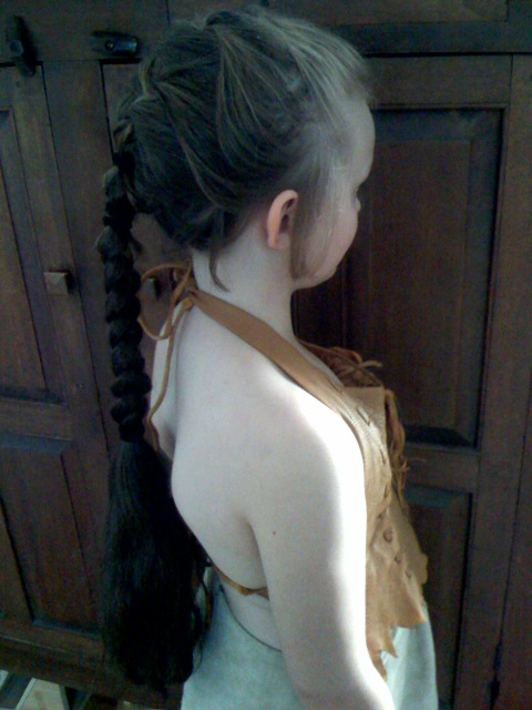 back of her hair in braid